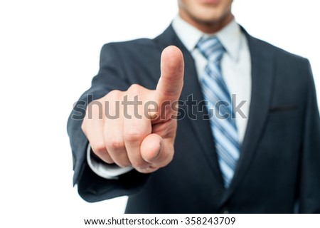 Cropped image of a businessman pointing his finger towards camera