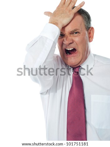 Cropped image of a disturbed businessman with  hand on his head - stock photo