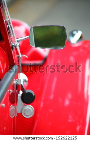 cropped image of a fully restored classic old car with lots of shiny chrome - stock photo