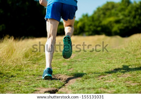 Cropped image of a sporty guy running