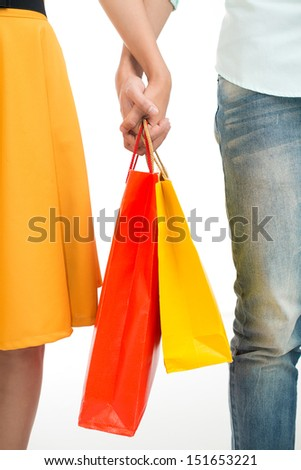 Cropped image of a young couple shopping together over a white background - stock photo