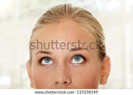 Cropped image of a young girl with her eyes looking up - stock photo