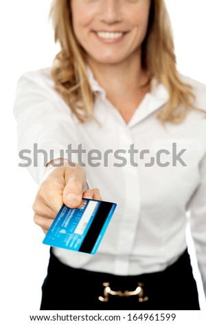 Cropped image of an executive showing debit card - stock photo