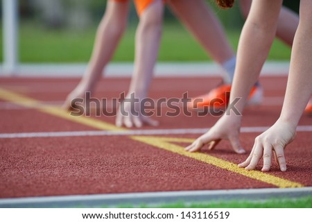 Cropped image of boys hands on start position at racetrack - stock photo