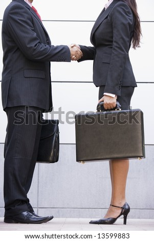 Cropped image of business meeting outside modern office - stock photo