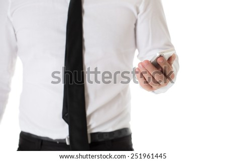 Cropped image of businessman in white shirt and black tie holding a mobile phone. Isolated on white background. - stock photo