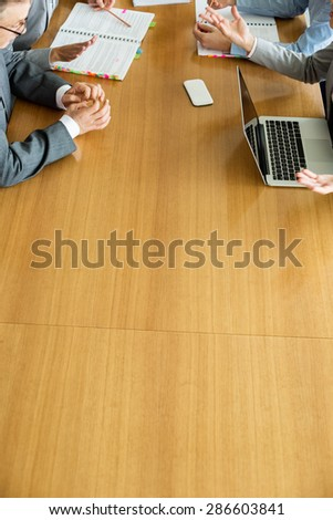 Cropped image of businesspeople discussing at conference table - stock photo