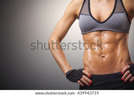 Cropped image of female model with muscular body - stock photo