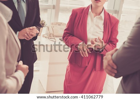 Cropped image of female team leader ennumerating plans for the day - stock photo