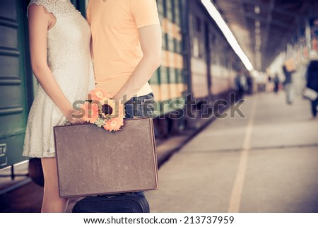 Cropped image of girl giving farewell kiss to her boyfriend at the railway station - stock photo