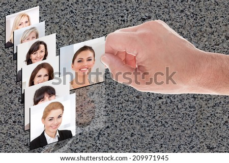 Cropped image of hand choosing the perfect candidate for the job - stock photo