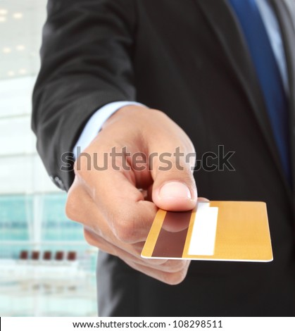 cropped image of hands paying using credit card - stock photo