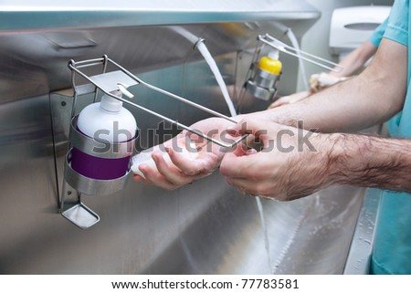 Cropped image of man washing his hand with hand sanitizer - stock photo