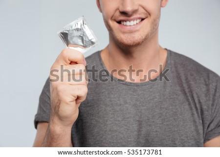 licks condom boy