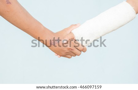 Cropped image of sportmanship shaking hands outdoors on white background. Forgiveness sportsmanship.
