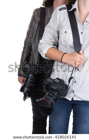 Cropped image of two women holding camera
