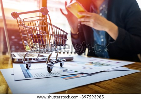 Cropped image of woman inputting card information and key on phone or laptop while shopping online. - stock photo