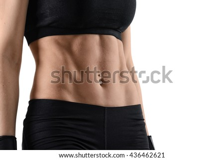 Cropped image torso of woman. Perfect abdominal muscles of fit female model isolated on white background. - stock photo