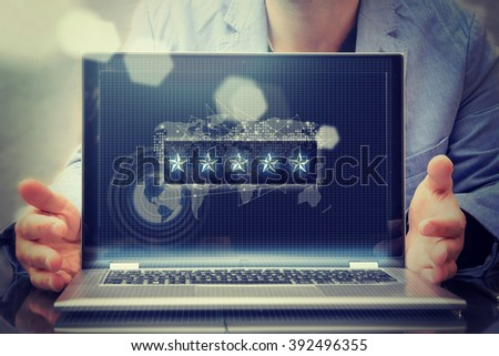 Cropped image view of man's hands in elegant suit keyboarding on laptop computer  - stock photo