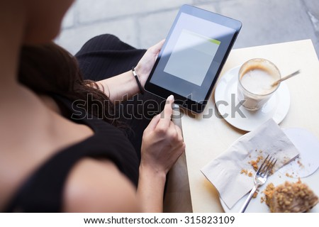 Cropped image woman's hands holding digital tablet with blank copy space screen for your text message or content, beautiful university female student browsing internet via touch pad during cafe break - stock photo