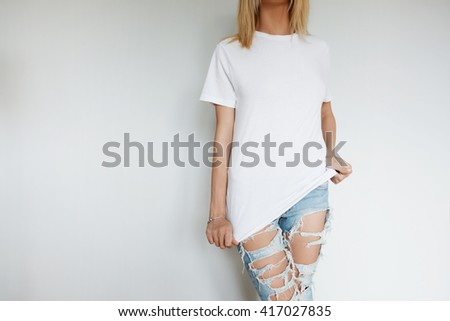 Cropped isolated shot of young blonde woman wearing casual clothes. Portrait of female bank worker changing her uniform to casual look before going out with friends in the evening. Lifestyle concept - stock photo