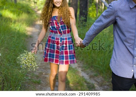 cropped picture loving couple strolling through the woods