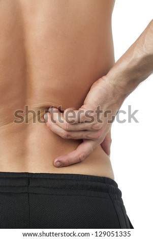 Cropped portrait of man holding his back as a sign of backache - stock photo