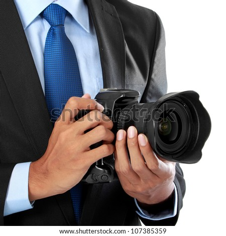 cropped portrait of professional photographer holding dslr camera