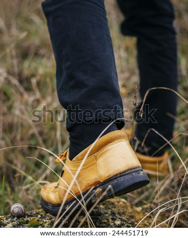 Cropped rear view of a hiker walking along a trail - stock photo
