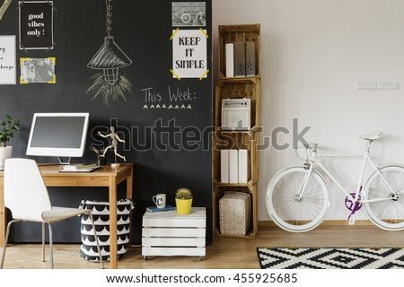 Cropped shot of a creative designed living room with a place to work - stock photo