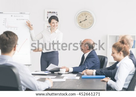 Cropped shot of a group of businesspeople during an important meeting - stock photo