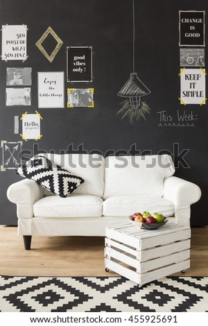 Cropped shot of a stylish living room with a handmade coffee table - stock photo