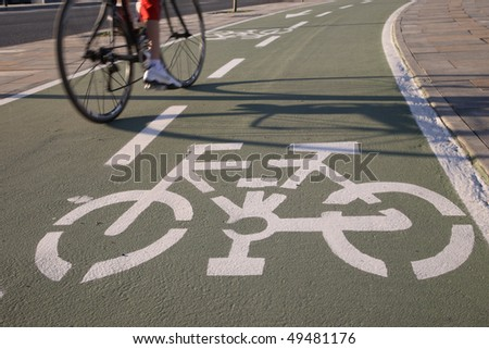 Cropped view of a bicyclist going the wrong way on a two-way bicycle path. Horizontal shot. - stock photo