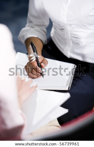 Cropped view of African American woman writing in notebook - stock photo