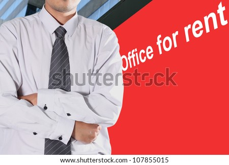 Cropped view of Businessman standing in front of a billboard with a red office for Rent - stock photo