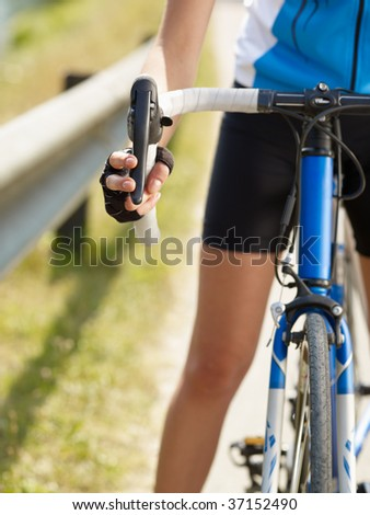 Cropped view of female cyclist with hands on brakes. Copy space - stock photo