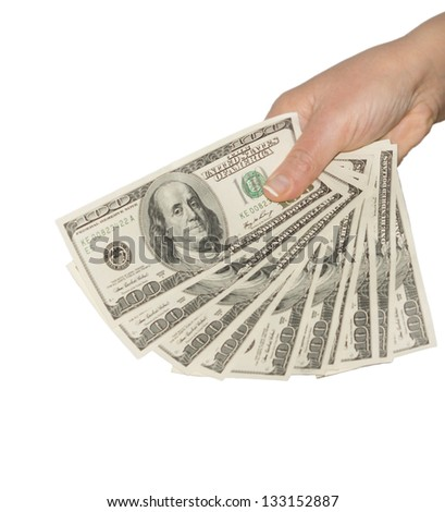 Cropped view of the hand of a man holding a fanned fistful of 100 dollar bills isolated on a white background