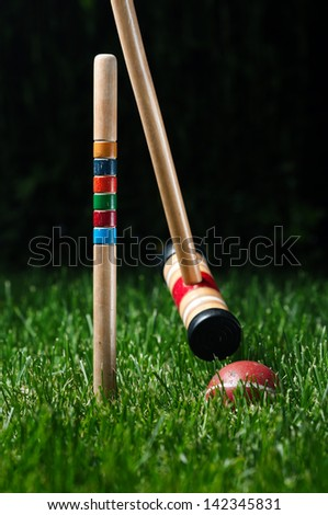 Croquet equipment at night time - stock photo