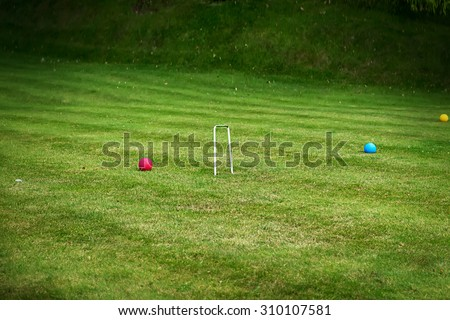 Croquet field with balls background. Image with selective focus - stock photo