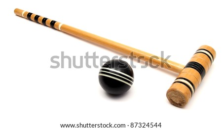 croquet mallet and ball over white - stock photo