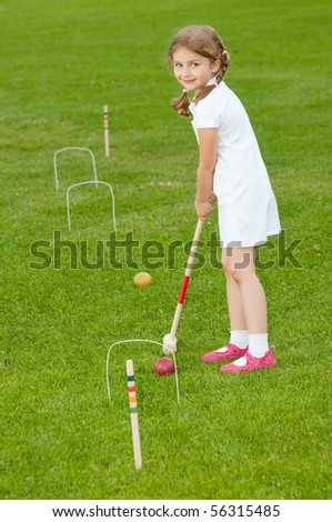 Croquet Player Making Score - stock photo
