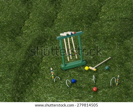 Croquet set with mallets and balls on a lawn of green grass - path included - stock photo