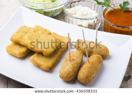 croquettes balls and different kind of sauces on a plate on a cl - stock photo