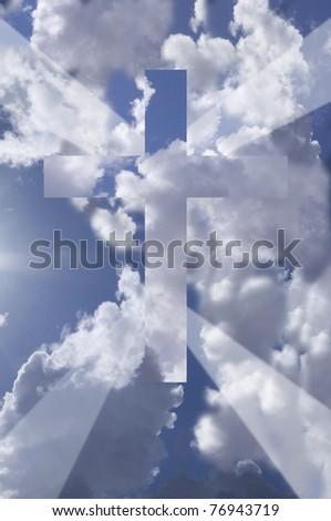 Cross against blue sky with dramatic clouds and rays of light - stock photo