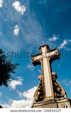 cross against cloudy blue sky - stock photo