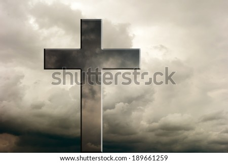 Cross against dramatic cloudy sky