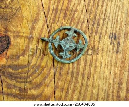 Cross ancient Kievan Rus on the wooden table  .age 10-13 - stock photo