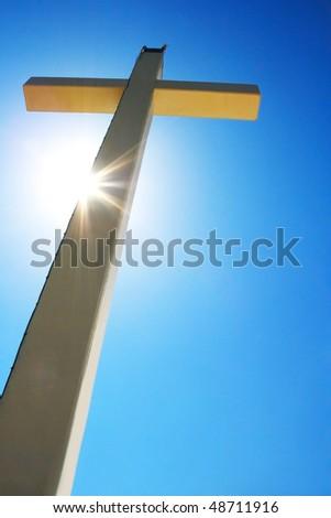 Cross and light on it. - stock photo