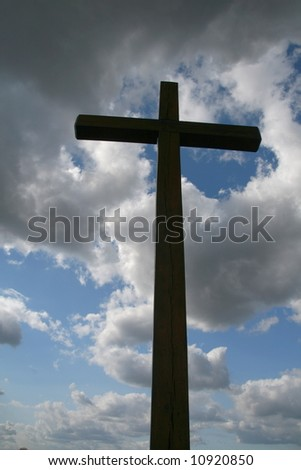 Cross and the cloudy sky