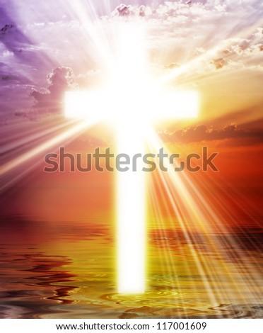 Cross appearing on sunrise sky - stock photo